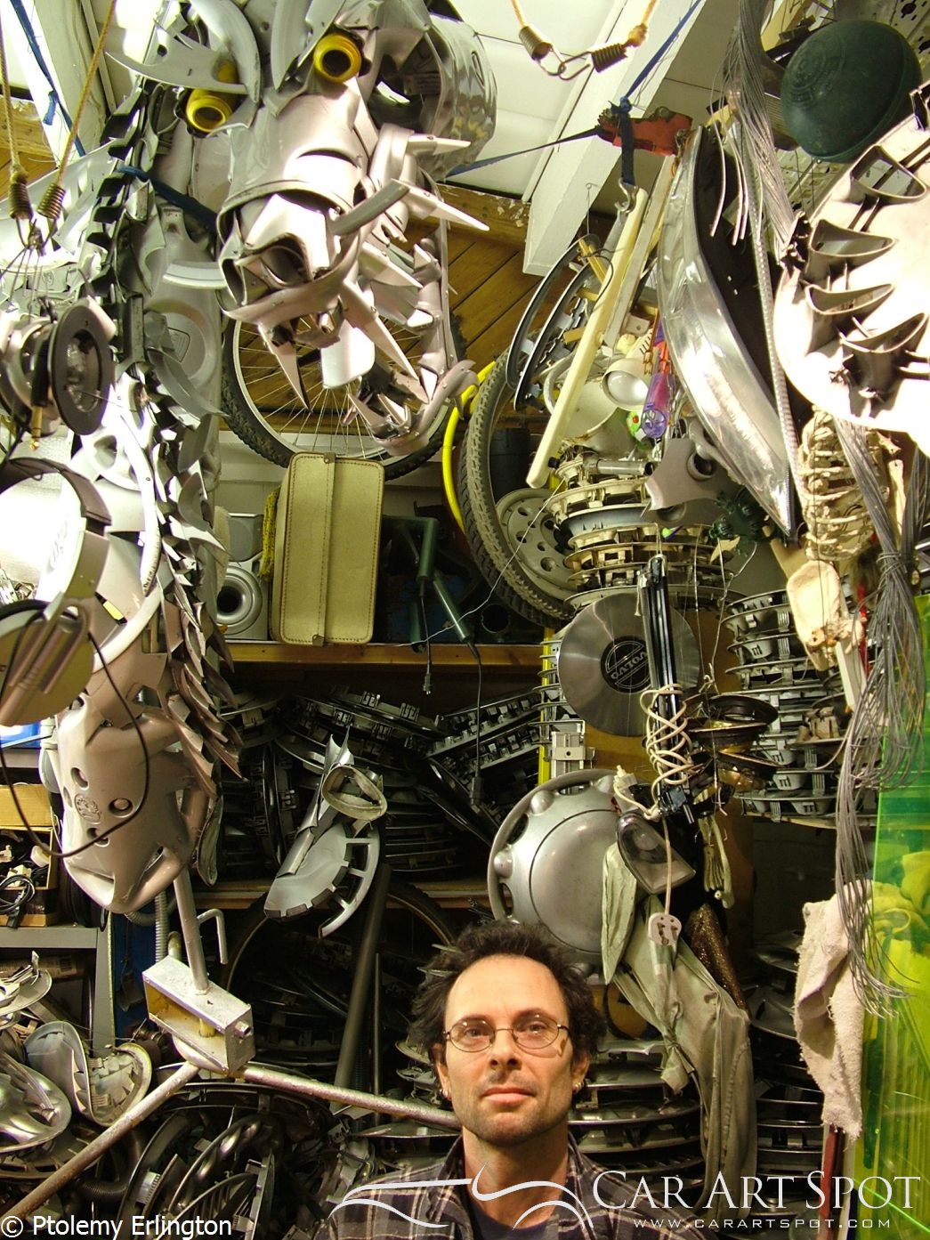 Ptolemy Erlington surrounded by his hubcap art